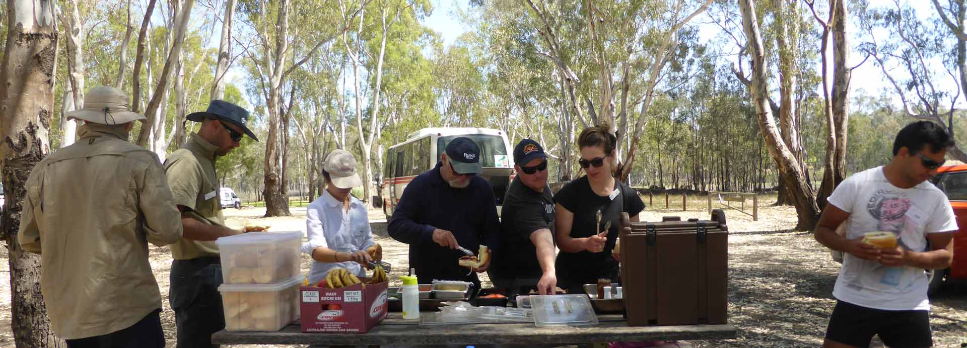 people having lunch at the flood plain ecology course