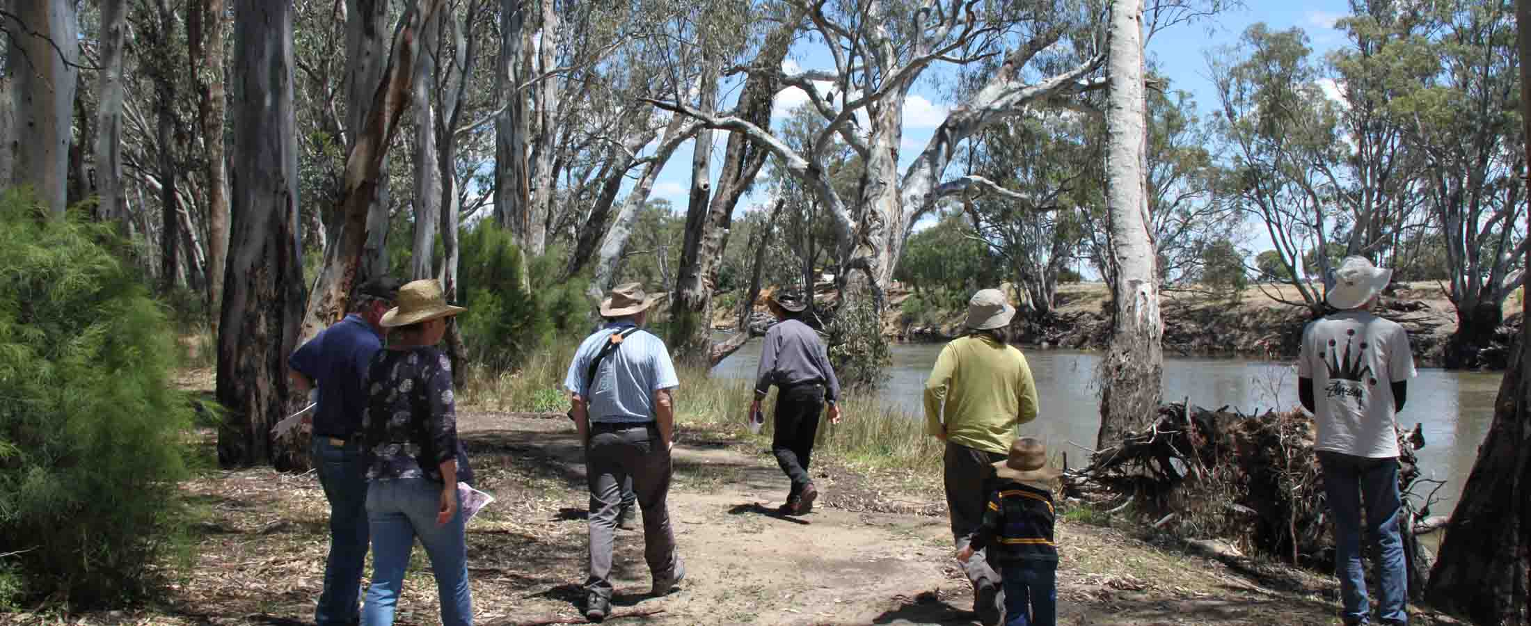 group walking along river